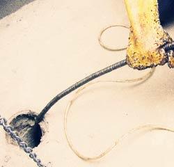 Corktown plumbers snaking a drain