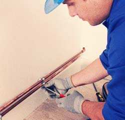 plumber in corso italia installing pipe