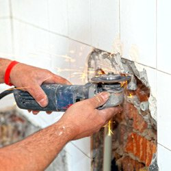 plumber conducting bathroom repairs