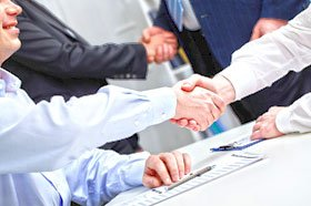 commercial plumbers shaking hands