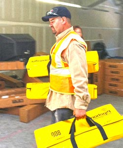 plumber carrying water leak detection equipment to jobsite
