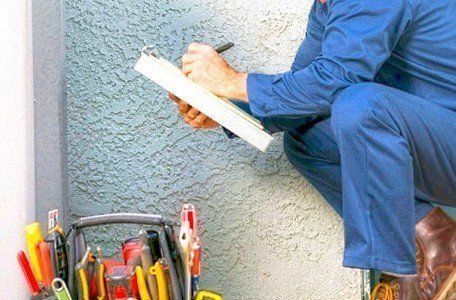 man inspecting plumbing