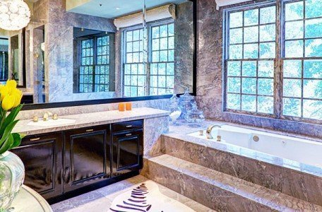 bathroom renovation project featuring marble and a great view