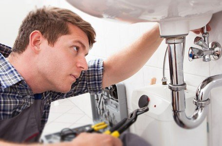 man in toronto that is fixing his bathroom sink