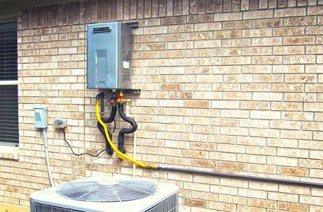 tankless water heater on the outside of a home