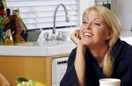 woman-smiling-in-kitchen