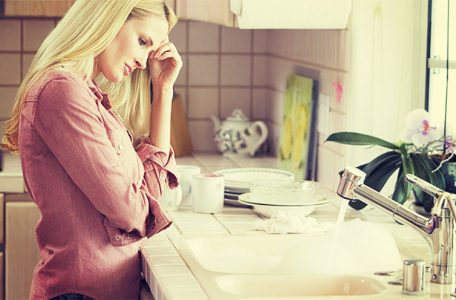 woman frustrated with clogged sink drain