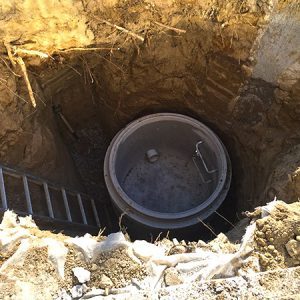manhole being constructed below the ground level