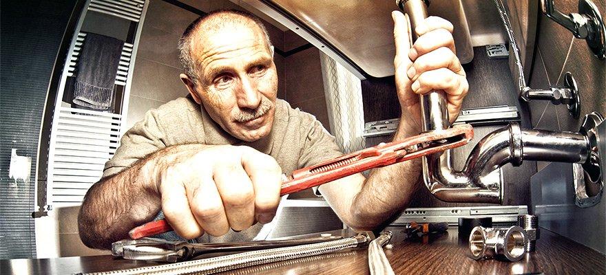 etobicoke plumbing contractor working on a sink drain