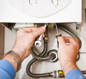 Milton plumbing contractor performing service on a water heater