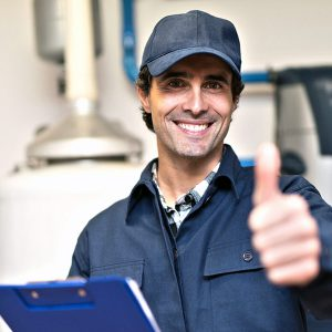 Toronto plumber giving a thumbs up after performing work on a home