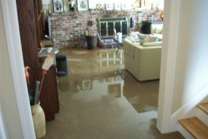 completely flooded home with soaking wet basement carpet flooring